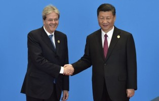 epa05965285 Italian Prime Minister Paolo Gentiloni (L) shakes hands with Chinese President Xi Jinping during the welcome ceremony for the Belt and Road Forum, at the International Conference Center in Yanqi Lake, north of Beijing, China, 15 May 2017. The Belt and Road Forum runs from 14 to 15 May, and it is expected to lay the groundwork for Beijing-led infrastructure initiatives aimed at connecting China with Europe, Africa and Asia.  EPA/KENZABURO FUKUHARA / POOL