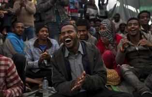 FILE -  In this April 7, 2017 file photo, migrants enjoy a music performance onboard of the  Golfo Azurro rescue boat a day after being rescued by members of Proactiva Open Arms NGO. (ANSA/AP Photo/Bernat Armangue, File) [CopyrightNotice: Copyright 2017 The Associated Press. All rights reserved.]