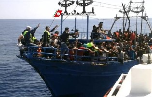 An undated picture released by Italian Guard Coast shows a moment of rescue near Libyan coast by  ships of  Guardia Costiera, in the afternoon 22 August 2015.ANSA/ UFFICIO STAMPA GUARDIA COSTIERA   +++ ANSA PROVIDES ACCESS TO THIS HANDOUT PHOTO TO BE USED SOLELY TO ILLUSTRATE NEWS REPORTING OR COMMENTARY ON THE FACTS OR EVENTS DEPICTED IN THIS IMAGE; NO ARCHIVING; NO LICENSING +++