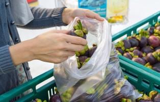 women buying fruit at supermarket