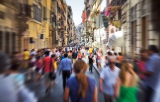 Crowd on a narrow Italian street. Motion blur effect.