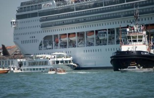 The MSC cruise ship Opera is seen after the collision with a tourist boat, in Venice, Italy, 02 June 2019. The cruise ship smashed into a dock located on the Giudecca canal in Venice this morning. Tugs could not maintain control of the MSC cruise ship as it violently struck the dock and then struck the stern of the 'River Countess' tourist boat which was docked. Four people were taken to the hospital. ANSA/ ANDREA MEROLA